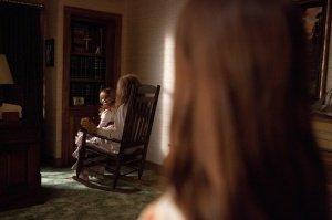 This picture is from THE CONJURING, but it's only in ANNABELLE that you meet the person holding her.